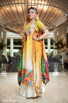 A Pakistani bride and groom celebrate their wedding festivities with a marvelous mehndi party!