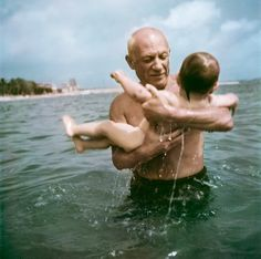 Pablo Picasso playing in the water with his son Claude, Vallauris, France, 1948, from Capa in Color | Excerptional color, son claud