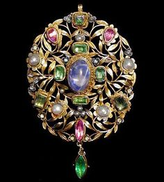 ARTHUR & GEORGINA GASKIN - A pendant of gold flowers and leaves set with a central cabochon sapphire, foiled emeralds, pink tourmalines, pearls, rose cut diamonds and with an emerald drop.