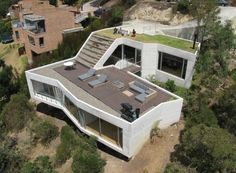 Casa V House Has a Green Roof Room With a View