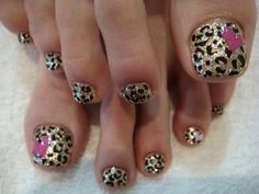 Gold leopard toes with pink hearts.