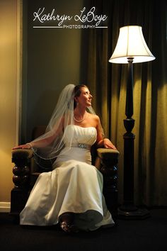 I saw this lamp and chair in another room and dragged it near the curtains, pop the bride in the chair with her face directed towards the light and created this vision of my beautiful new sister-in-law.   McMenamins Edgefield Wedding Photography, Kathryn LeBoye Photography