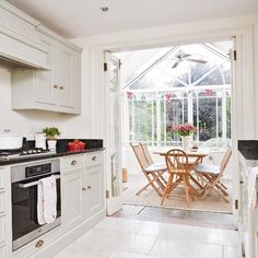 Open-plan kitchen and conservatory | Open-plan living | Conservatory ideas | Image | Housetohome