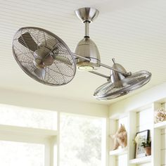 Fredrickson Ceiling Fan, Silver | Anchored by a bright halogen bulb, this high performance dual ceiling fan adds an industrial element. Two rotating caged fans adjust in speed and direction to bring a refreshing breeze indoors.