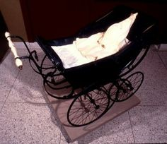 Maryland Historical Society: Fred Wilson, Mining the Museum: Baby carriage with KKK mask