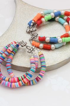 Fun rainbow bead bracelets. These 3 stranded layer bracelets create instant boho stacking bracelets.#jewellery #bracelet #colourful #beaded #boho #colours #rainbow #beads #summer #fun Seashell Necklace, Beaded Necklace, Beaded Bracelets, Stacking Bracelets, Layered Bracelets, New Jewellery Design, Summer Jewelry, Becca, Handmade Necklaces