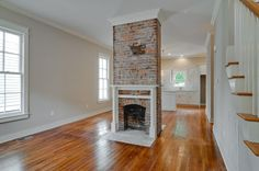 Exposed brick fireplace restored by Building Masters