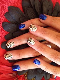 Electric blue with freehand leopard nail art