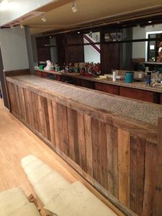 My girlfriend is opening a cafe. She made this bar out of old pallets. - Imgur