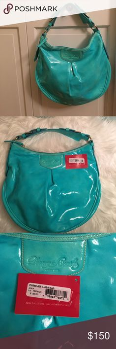 "NWT Dooney and Bourke turquoise Luisa bag NWT Dooney and Bourke turquoise Luisa bag.       Single adjustable shoulder strap, top zip entry, embossed signature logo on front wall Interior front-wall slip pocket, back-wall zip pocket, key leash Measures approximately 14-1/2""W x 12""H x 2-1/2""D with a 6"" to 8"" strap drop Body/trim 100% leather with patent coating; lining 100% cottonOffers welcomed 🙂👍🏻 Dooney & Bourke Bags Shoulder Bags"