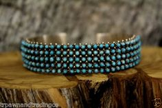 sterling silver bracelet w/5 rows of small turquoise stones by Steven Haloo