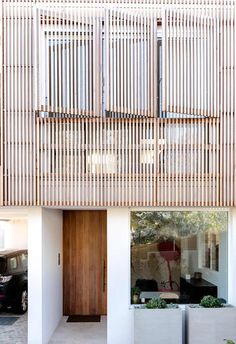 Timber screens and a warm timber door add a relaxed coastal style to this contemporary home.