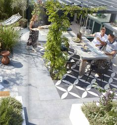 patio - outdoor kitchen with concrete counters, simple table, simple arbor