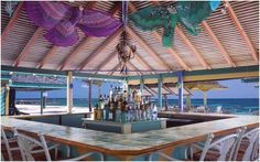 Sip cool cocktails and Carib beers at Sea Breeze Beach Bar at Nisbet Plantation Beach Club, #Nevis, #Caribbean. nisbetplantation.com