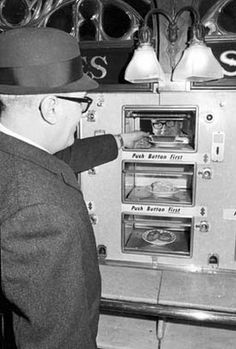 Serving one of the last slices of pie to go through a window in the nation's first automat restaurant in Philadelphia, is Ralph MacNeil, an official of Horn & Hardart. The firm closed the restaurant in December 1968, blaming the closing on its inefficiency and slowness.