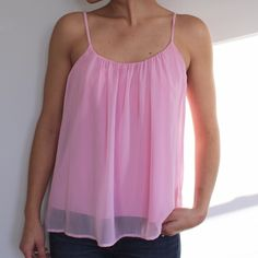 Light pink Tank Top from LuLus Light pink Tank Top from LuLus. Pink chiffon with a scoop front and low scoop back. Adjustable straps and only worn a few times. Excellent condition! No trades sorry! Lulu's Tops Tank Tops
