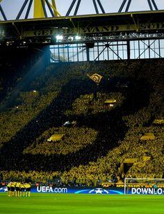 Dortmund's supporters choreograph their club's logo on the tribune during the UEFA Champions League 1st leg quarter-final football match BVB Borussia Dortmund v Monaco in Dortmund, western Germany on April 12, 2017. / AFP PHOTO / SASCHA SCHUERMANN