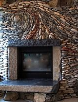Another swirly design, rock fireplace inlaid stone. Love this.