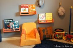 Spice rack shelves for organizing kids books. Great idea. Don't like the colors here, but great idea.
