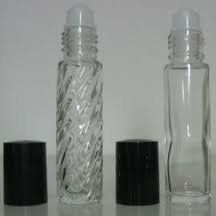 "2 Roll-on Refillable Glass Perfume Bottles ""Plain & Swirl"" With 2 - 5ml. Droppers For Easy Filling Purse or Travel Size. 1/3oz. 10ml. by Natural Cosmetics. $3.49. Includes: 2 - 5 ml.  droppers for easy filling. FREE SHIPPING. clear glass bottles with a Plain and Swirl design and roll-on applicator. Bottles are about 3.5 inches tall with caps on and hold 10mL of liquid-- or 1/3 of a fluid ounce.. Perfect for storing perfume oils or other liquids. FREE SHIPPING !!!!!!!!!!! ..."