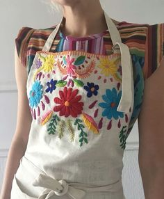 Handmade linen apron with front pockets and adjustable neck strap & adjustable ties Hand embroidered at neckline with Mexican inspired folk embroidery One size Unlined Mexican Embroidery, Folk Embroidery, Embroidery Fashion, Cross Stitch Embroidery, Embroidery Patterns, Embroidered Apron, Embroidered Clothes, Patchwork Quilt, Linen Apron