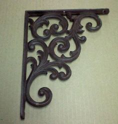 Wrought Iron Bracket to support a simple shelf. To be used in place of a nightstand.