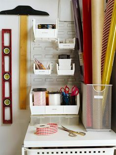 Organize gift wrap supplies with a corner of a closet to store paper, boxes, and tissue paper. More clever closets: http://www.bhg.com/decorating/closets/reach-in/clever-closets-around-the-house/?socsrc=bhgpin060812