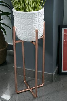 How To Make A Diy Copper Plant Stand Diy Copper Plant Pot Stand Plant Pot Holder White Plant Pot Display Houseplant Plant Pot Stand Ideas Planters Metal Spaces Plant Pot Stand Projects Decor Home House Inspiration Indoor Plants Zebra Grass Copper Decor, Diy Plant Stand, Metal Plant Stand, Indoor Plant Stands, Plant Holders Diy, Modern Plant Stand, White Plants, Potted Plants, Indoor Plants