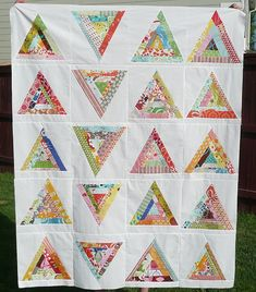 """https://flic.kr/p/6FWrj1   triangle quilt top   Finished the quilt top due to a rare weekend nap by my 3 year old!  I pieced this right after my string quilt when all the leftover stripes were laying about. I laid out the triangles in various ways and like this one the best. I came up with this triangle idea a while ago and had been itching to try it out. Blocks are 10.5"""".    Only scraps were used to make this quilt which is why some of the color strips are pieced. The white is from a 1..."""