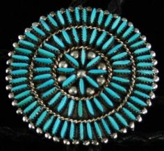 Vintage Zuni Needlepoint Bolo Tie #Zuni This marvelous needlepoint bolo was made in Zuni pueblo in the 1970 to 1980 era. Labor intensive and made with precision, bolo ties of this design are seldom made today. Each tiny natural turquoise cabochon is cut and set, most likely from the Sleeping Beauty mine in southern Arizona. Perfectly braided wire and hand made droplets are used as borders to the stone. The tie is a perfect fashion statement or a fine addition to a collection.