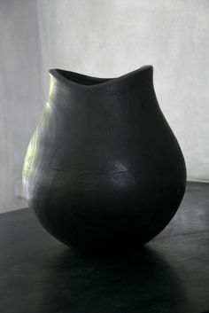 Blackwashed teak vase by NOMAD LIVING