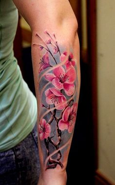 Beautiful and detailed cherry blossom tattoo on the arm. You can see a group of cherry blossoms seemingly embraced by the wind as display their enchanting beauty for the world to see.
