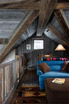 Cozy living room under the rooftop with open wood ceiling