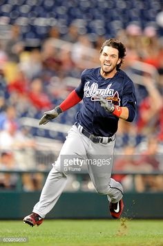 News Photo : Dansby Swanson of the Atlanta Braves runs the...