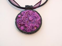 Polymer Clay on buna cord and ribbon, via Flickr.