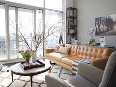 Learn how Apartment 34 lifestyle blogger and publicist Erin Hiemstra and her husband make their 900-square-foot loft feel liveable.