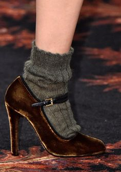 Brown velvet shoes with chunky olive coloured woollen socks