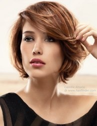 Short bob, with feathered ends that curve inward. Side swept bangs. http://www.hairfinder.com/hairstyles9/follow-hairstyle5.htm