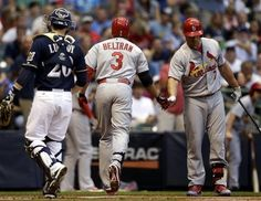 Brewers catcher Jonathan Lucroy watches as Carlos Beltran is congratulated by Matt Holliday after Beltran hit a home run during the first inning...Cards won the game 8-5.   8-19-13