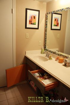 Painted cabinets and glass tile mirror trim