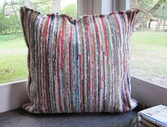 Make Durable Floor Cushions From a Rag Rug >> http://blog.diynetwork.com/maderemade/2013/08/16/diy-rag-rug-floor-cushions?soc=pinterest