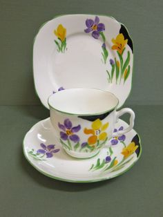 On offer here is a beautiful vintage Royal Albert trio in excellent condition with delightful hand painted floral decoration and green borders. The design has a fresh and inviting feel to it like the season Spring. Take note of the earlier backstamp. There are no chips, cracks or restoration. Also listed is the matching sugar and creamer.Please view images provided for a visual condition report. Happy to answer any questions in relation to this item. Postage cost according to postcode…
