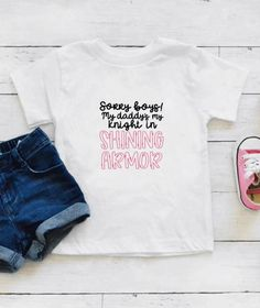 Sorry Boys! My Daddys My Knight In Shining Armor Baby Bodysuit or Toddler T-Shirt. This is a perfect gift.  *When ordering: SS = Short Sleeve, LS = Long Sleeve *Bodysuits are Carter's brand. Please see their sizing chart if you aren't sure what size to order. *All bodysuits are white. The color you
