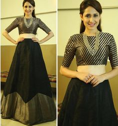 Glam Gal - Pragya Jaiswal, winner of Best Debutant by Filmfare for movie Kanche, Telugu movie. Glam Check - This outfit and the make-up looks like an ocean of trend in one stylish look  All that glitters is GOLD!! The stripes trend is bang on here with gold and black setting the tone of a perfect night out. The voluminous black skirt with gold hem makes the look appear larger than life. The delicate gold jewelry in V shape is a stunner. Her complexion looks flawless.