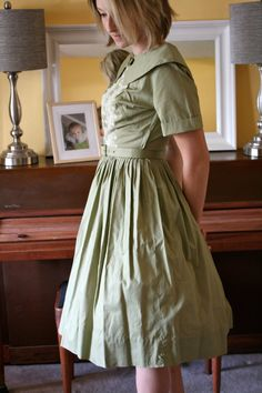 It's all in the details. Vintage Full Skirted Dress, Sage Green, Eyelet Detailing. $18.99, via Etsy.