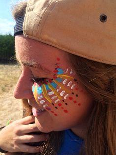 Tribal face paint music festival makeup Aztec design