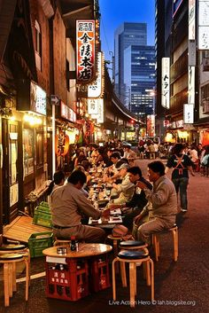 Would love to eat on a street in Tokyo. Reminds me of Little Italy in NYC.