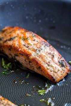 This delicious and easy Greek Salmon is the perfect quick healthy dinner for the whole family. The marinade is a simple mix of olive oil, lemon, dill, and oregano. The fish is pan-fried, giving it a wonderfully crisp exterior and meltingly tender and succulent center. Perfect for serving with orzo and a Greek salad. Transport your self to Greece with the traditional and authentic recipe for Greek Salmon! Greek Salmon Recipe, Salmon Recipe Pan, Delicious Salmon Recipes, Grilled Salmon Recipes, Best Seafood Recipes, Healthy Recipes, Fish Recipes, Healthy Foods, Healthy Eating