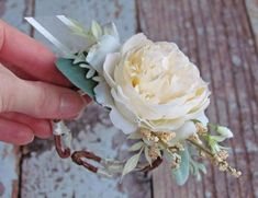 This boho style wrist corsage was made on a wired twig wristband. This corsage is adjustable and can be made larger or smaller to meet any wrist size! It is simple and charming, made to last forever. This one has been made with an ivory rose, lush greenery & berries. With a small ivory bow attached. It measures about 3.5 wide and 2.5 long. Contact me with any adjustments or color changes, this is completely customizable! This item ships Priority Mail. Follow Just Anns for more photos... ...