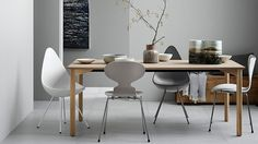 Drop chair, Ant chair, Series 7 chair and Grand Prix table by Arne Jacobsen from Fritz Hansen | ICFF